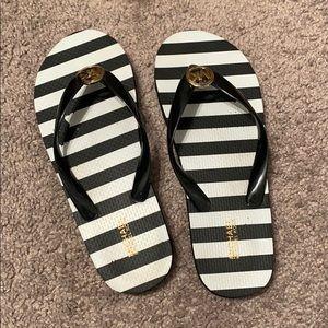 black and white michael kors flip flops